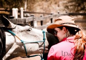 The partnership. Koyote kisses Laura.
